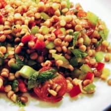 Couscous salad with chopped vegetables, mint, and cilantro