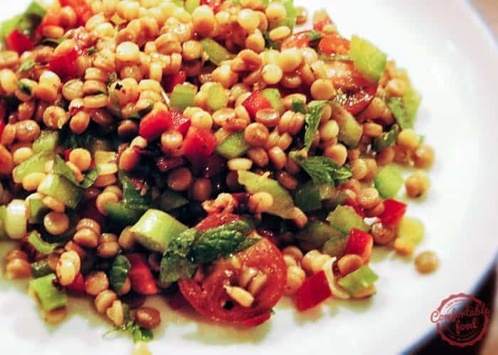 Couscous salad with chopped vegetables mint and cilantro