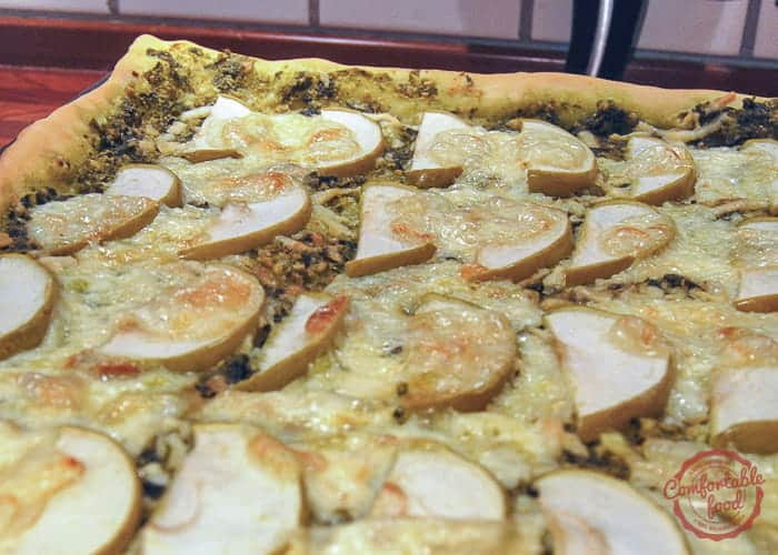 Homemade pizza recipe with apples, pesto and brie.