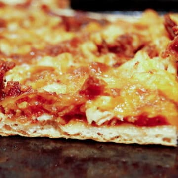 An easy homemade BBQ pizza with chicken and bacon.