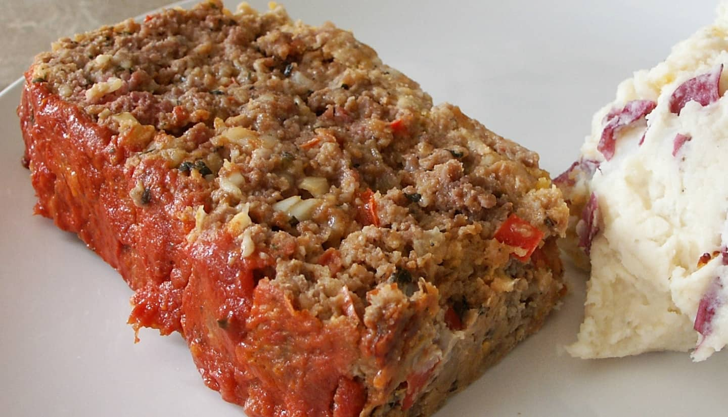 Sliced of italian meatloaf with mashed potatoes as side dish