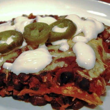 Vegetarian enchiladas with black beans and jalapeno cheese on top