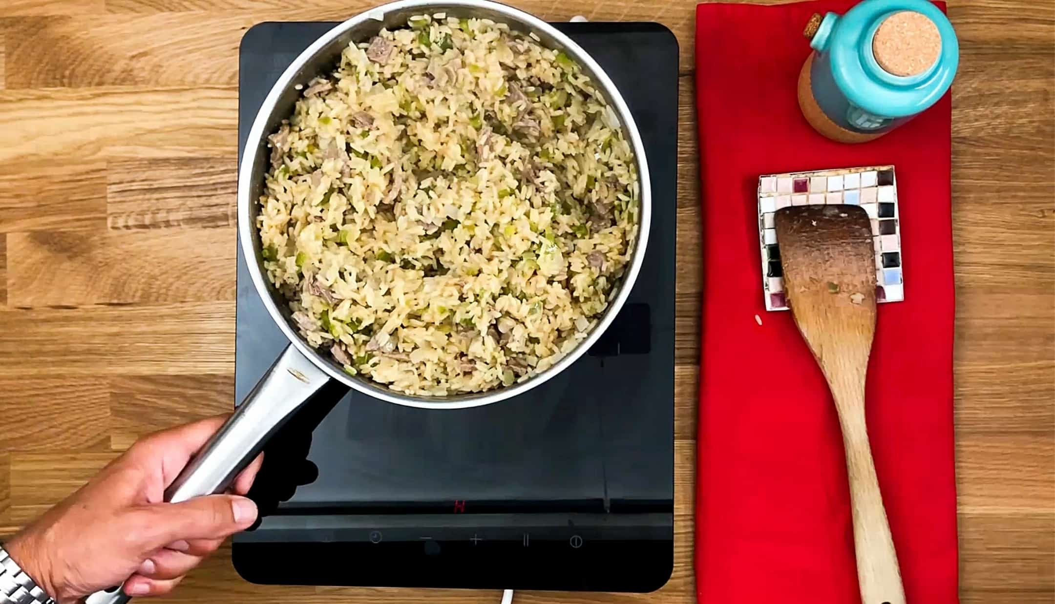 Beef fried rice cook on a stove